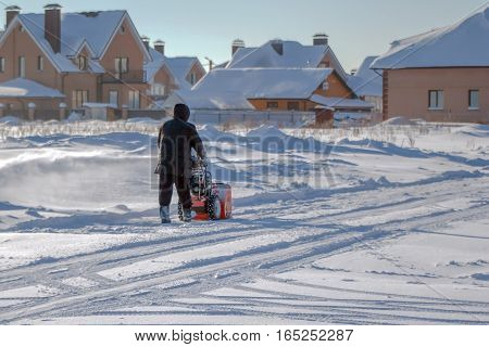 A Man Cleans The Road From Snow