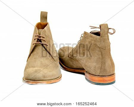 Men's almond suede boots isolated on white