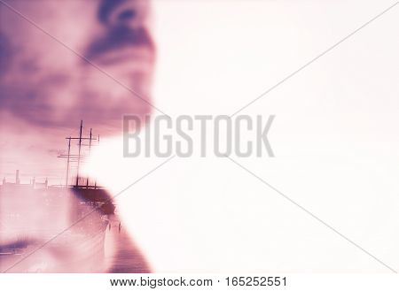 Double exposure of a young man and Gothenburg harbor in sunset.