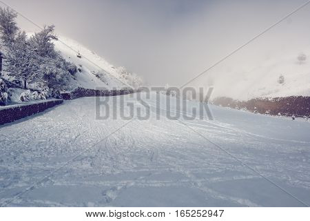 Ramp on snowy mountains partially covered by clouds
