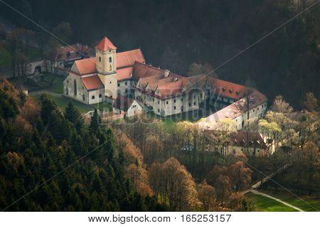 Red Monastery in Pieniny mountains among trees Slovakia