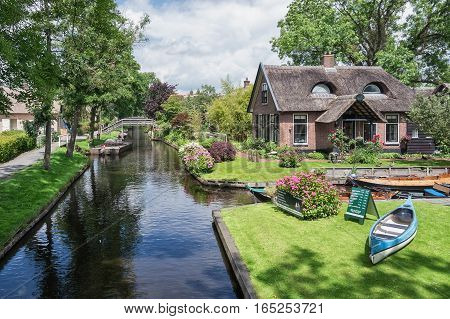 Giethoorn, Netherlands - June 29 2016: A thatched cottage that looks like a cat.