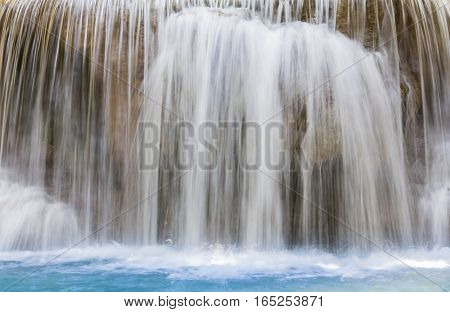 Close up natural blue stream waterfall long exposure