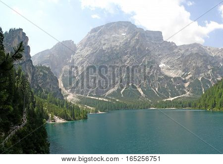 surrounded by the high mountains of the Dolomites of Braies lies the idyllic Lake Braies landscape in South Tyrol, Italy
