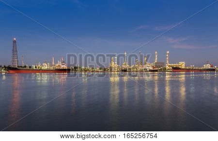 Panorama Oil refinery river front with twilight sky background