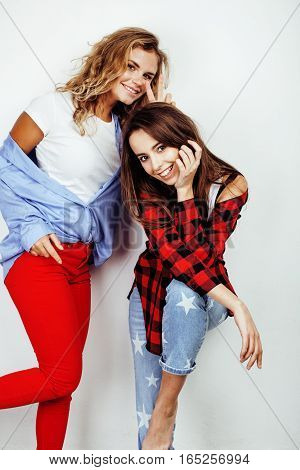 two best friends teenage girls together having fun, posing emotional on white background, besties happy smiling, making selfie, lifestyle people concept close up