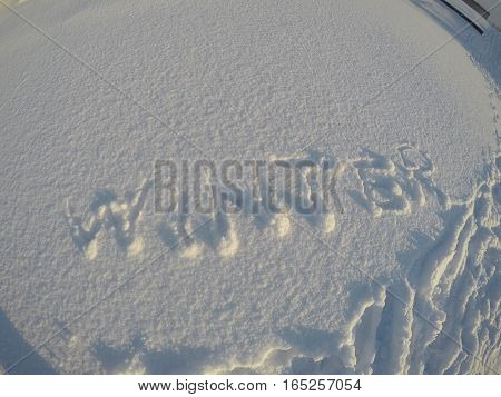 The Word Winter Written In The Snow