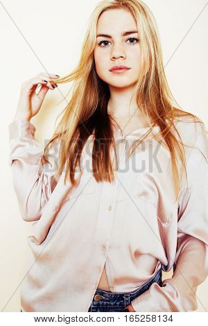 young pretty blond teenage girl close up portrait, lifestyle people concept, teens fashion