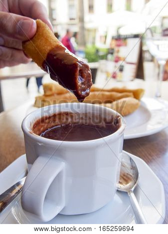 Churros con chocolate are a popular Spanish dessert. The fried churros are intended to be dipped in the rich hot chocolate.