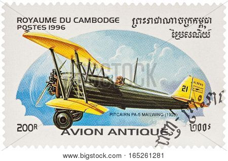 MOSCOW RUSSIA - January 10 2017: A stamp printed in Cambodia shows American airplane Pitcairn PS-5 Mailwing (1926) developed to carry Air Mail series