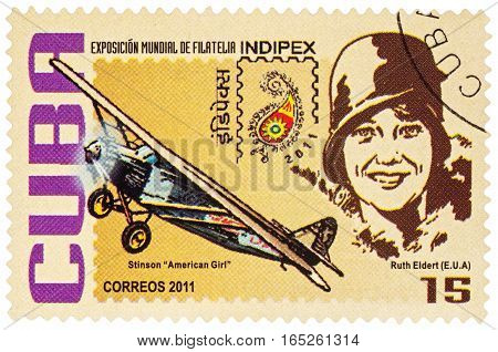 MOSCOW RUSSIA - January 15 2017: A stamp printed in Cuba shows American pilot Ruth Elder and her airplane Stinson 'American Girl' series