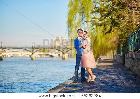 Romantic Couple On The Seine Embankment In Paris