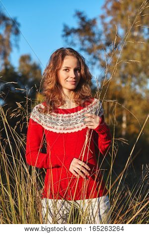 Beautiful Young Woman In Red Sweater In Autumn Park