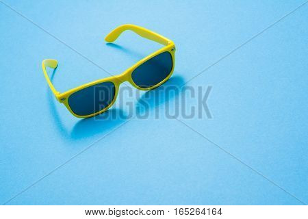 Modern sunglasses on colorful background with copy space. Product photograph with room for text.