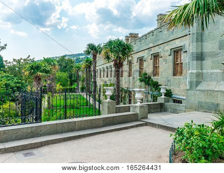 Shuvalov outbuilding and garden with palm trees in the Vorontsov Palace in Alupka Crimea Russia