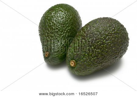 Two whole Hass Avocados  isolated on white