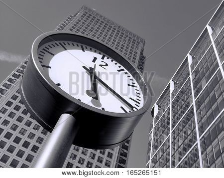 London, UK, September 26, 2009 :  Black and white image of Time is Money in Canary Wharf which is the largest business development in East London built on the site of the old West India Docks on the Isle Of Dogs