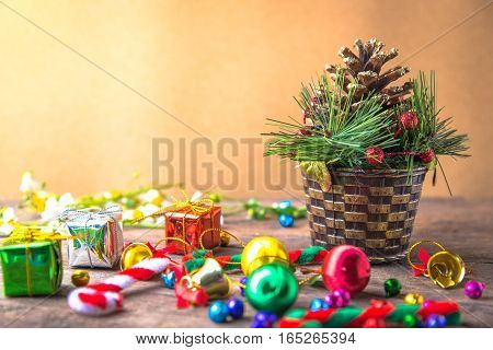 Christmas and new year wooden background banner with cane pine gift box daisy flower candy ball and decoration on vintage wooden background.