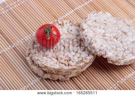 crispbread and cherry tomatoes on a bamboo Mat. vegetarian food