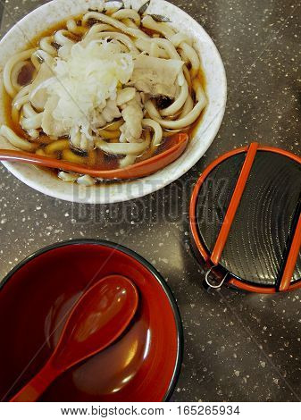 Udon noodles in broth is a common Japanese lunch option.