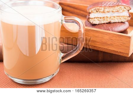 Glass Mug With Hot Cocoa And Chocolate Biscuits In A Wooden Tray