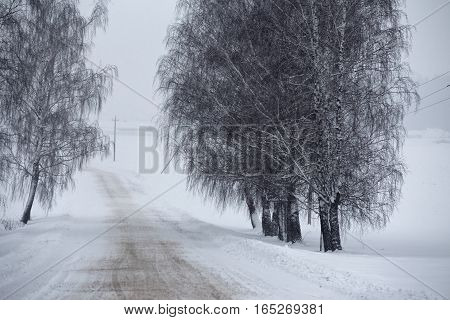 Snowfall And Sleet On Winter Road. Ice Snowy Road. Winter Snowstorm