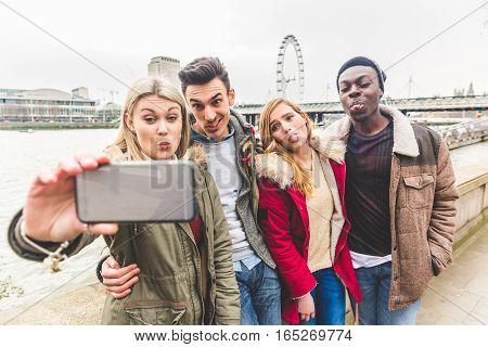 Group Of Friends Taking A Selfie In London
