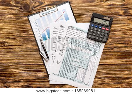 Tax form with calculator and graph on the table.