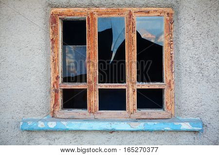 broken glass of old window of abandoned house