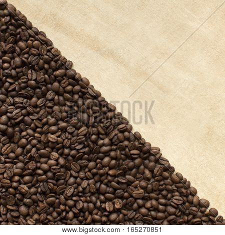 Coffee beans scatted on table background. Copy space