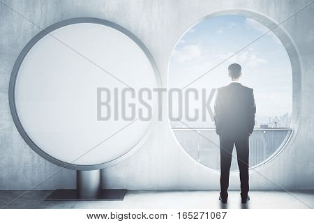 Man In Room With Round Banner