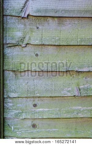 Weathered wooden fence.  Shot of a section of a wooden fence panel showing age and weather.