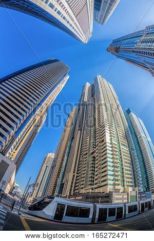 Dubai City With Tramway Against Skyscrapers In United Arab Emirates