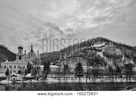Churches of Sviatohirsk Lavra. Cloudy day in January. On the waterfront