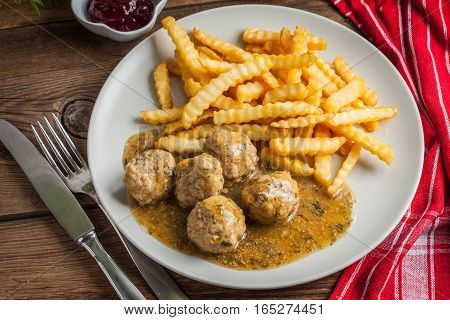 Meatballs With French Fries In Dill Sauce.