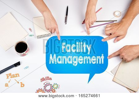 Facility Management. The meeting at the white office table.