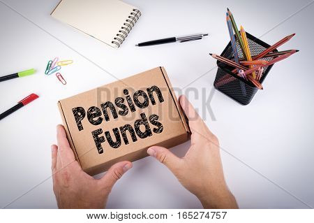 Pension Funds concept. Courier delivered  box to the office.