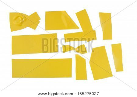 Collection of used yellow electrical tape pieces