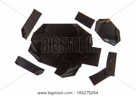 Collection of used black electrical tape pieces