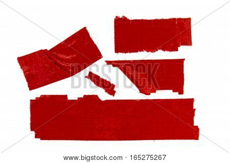 Collection of used red duct tape pieces
