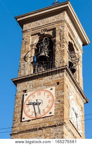 Old bell tower with watches in Bergamo town, Italy