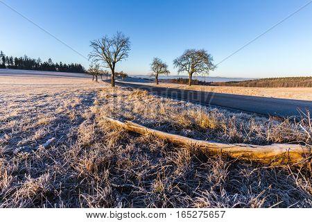 Winter landscape at sunrise and road. Moravian landscape Okrouhla.