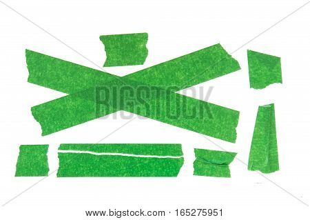 Collection of green used masking tape pieces