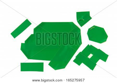 Collection of used green electrical tape pieces