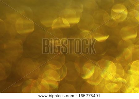 gold bokeh circles for Christmas background light and blurred boke