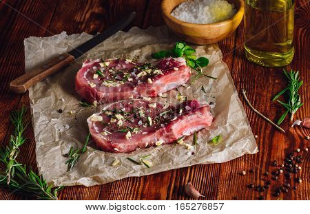 Two Rib Steaks with Spices Prepared for Frying.