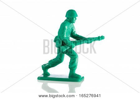 Miniature plastic toy soldier on white background