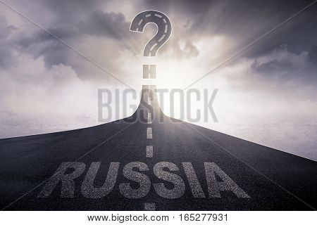 Image of empty asphalt road with word of Russia and question mark at the end of a road