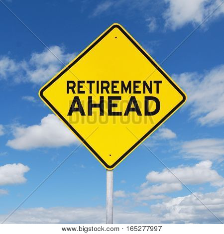 Image of yellow signpost with a text of retirement ahead shot under blue sky with white cloud