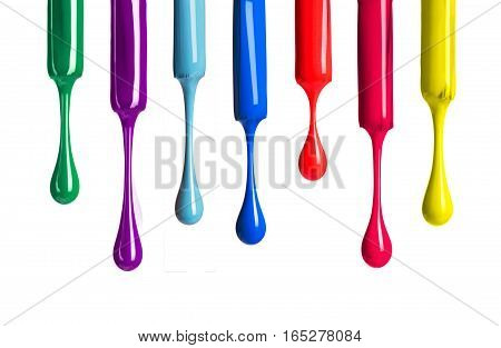 colored nail polishes drop isolated on white background